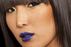 Close-up view of stylish Asian woman looking away Royalty Free Stock Photo