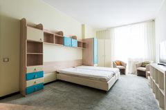 Close up view of stylish bedroom with wooden closet. And bed stock photos