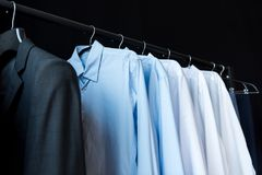 Close-up view of stylish male shirts on hangers. In boutique Royalty Free Stock Images