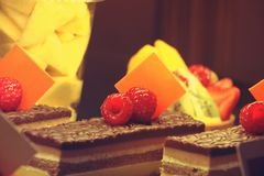 Close-up view of SWEET DESSERT with raspberry on top,UAE ON FEBRUARY 22 2017. Fruits and chocolate pastry with raspberry on top,UAE ON FEBRUARY 22 2017. Sweet Royalty Free Stock Photo