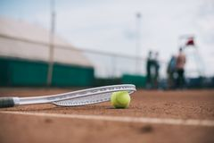 close up view of tennis ball and racquet on court stock photo