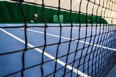 Tennis grid, macro. Close-up view of tennis court through the net, macro Royalty Free Stock Photos