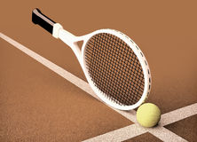 Close up view of tennis racket and ball on the tennis court. Close up view of tennis racket and ball on the clay tennis court Royalty Free Stock Image