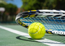 Close up view of tennis racket and balls on  clay tennis court Stock Images