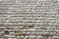 Close up view of a textured stone wall of a historical building Royalty Free Stock Photo