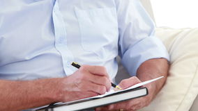 Close up view of a therapist man taking notes stock footage