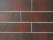 Close Up view of tile brick ceramic granite panels made in the color of brown. Fragment of the surface of the wall. can be used as Stock Image