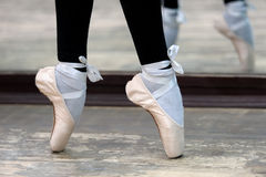 Close up view to ballerinas legs in pointes on Stock Images