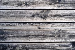 Vertically oriented grey planks of old wooden garden table under the sunshine. royalty free stock photography