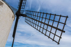 A close-up view to an old windmill. On the hill near Consuegra Castilla La Mancha, Spain, a symbol of region and journeys of Don Quixote Alonso Quijano Royalty Free Stock Images