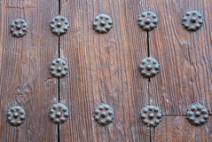 A close-up view to a part of old brown wooden door Stock Photo