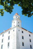Close-up view to a tower of Bratislava castle. And green maple leaves, Slovakia Royalty Free Stock Photos