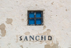 A close-up view to a window of an old windmill on the hill near Consuegra Stock Images