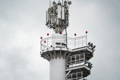 Close-up view of the top of modern stadium floodlight mast. Close-up view of the top of contemporary stadium floodlight mast with searchlights, multiple cellular Royalty Free Stock Images