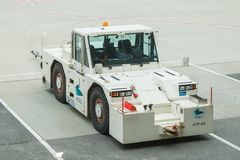 Airplane Tow Truck. Close up view of a tow vehicle used to tow airplanes onto the runway royalty free stock photos