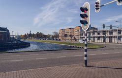 Close up view of traffic lights and canal of Den Helder. Close up view of traffic lights and canal in cityscape of Den Helder stock photography