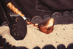 Close up view of turkish coffee prepared on hot golden sand. Coffee preparation concept Stock Images