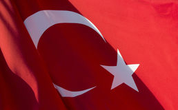 Close up view of Turkish flag waving. Strong shadows on it Royalty Free Stock Photos