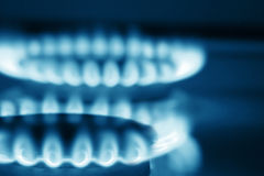 Close up view on two burners of cooker (blue toned Stock Photography