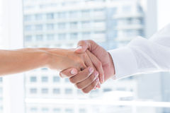 Close up view of two business people shaking hands Stock Photography