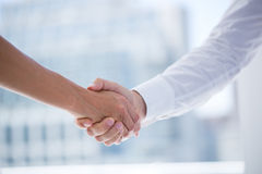 Close up view of two business people shaking hands Royalty Free Stock Image