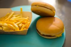 Hamburgers and fries. Close up view of two hamburgers and french fries Royalty Free Stock Image