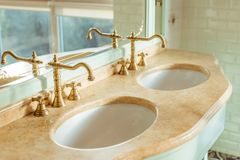 Close-up view of two luxury sinks. In bathroom stock photos