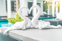 Close up view of two nice towels swans on bed Royalty Free Stock Images