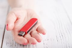 Close up view of usb flash pendrive in female hand Royalty Free Stock Images