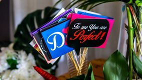 Close up view of the variety colorful wedding wishes placard or party props collections on the table