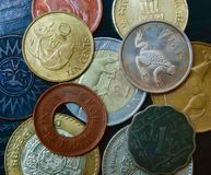 A close up view of various coins from around the world royalty free stock image