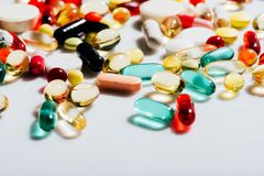 Various colorful pills. Close-up view of various colorful pills and capsules on grey Stock Photo
