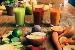 Close-up view of various fruit and vegetable smoothies in glasses. On table stock image