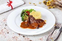 Close up view on veal cheeks with brocolli and potato muss. stock photo