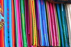 Close up View of Vibrant Indigenous Mayan Textiles. Red, blue, yellow, green, pink colors all stand out in beautiful striped patterns of the local Indigenous Stock Photography