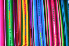 Close up View of Vibrant Indigenous Mayan Textiles. Red, blue, yellow, green, pink colors all stand out in beautiful striped patterns of the local Indigenous Royalty Free Stock Photos