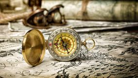 Close-up view of a vintage compass on an old retro map royalty free stock photo