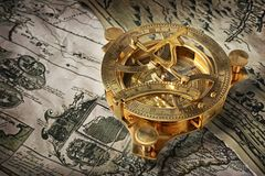 Close-up view of a vintage compass on an old retro map Royalty Free Stock Image