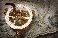 Close-up view of a vintage compass on an old retro map Stock Photo