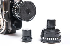 Close up view of vintage movie camera with lens isolated on whit Stock Image