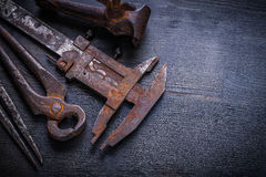 Close up view vintage rusted tools on old board Stock Images