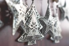 Close up view of vintage silver Christmas tree decorations stock photo