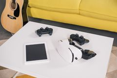 close-up view of virtual reality headset, digital tablet with blank screen and joystick royalty free stock image