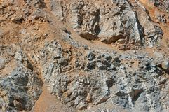 A close-up view of the walls of an old abandoned quarry. Royalty Free Stock Photography