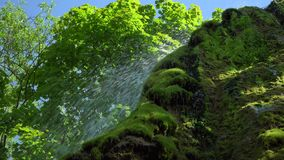 Close-up view of Waterfall in Deep forest blue lagoon. Best place. Travel tour concept, nature landscape. stock footage