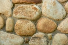 Close-up view of weathered stone wall texture full frame background stock photo