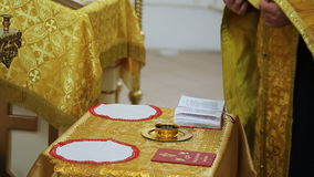 Close up view of wedding altar in orthodox church. Priest is preparing for wedding in front of God with help of wearing long golden cassock made of expensive stock footage