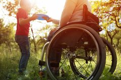 Close-up view on the wheels of a wheelchair. Bright stock photo