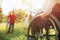 Close-up view on the wheels of a wheelchair. Bright royalty free stock images