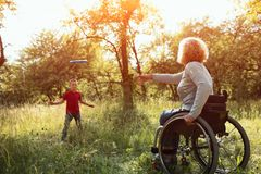 Close-up view on the wheels of a wheelchair. Bright stock photos
